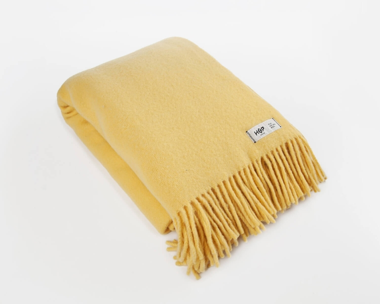 Wolldecke gelb Uni Yeti aus neuseeländischer Schurwolle mit eleganten Fransen